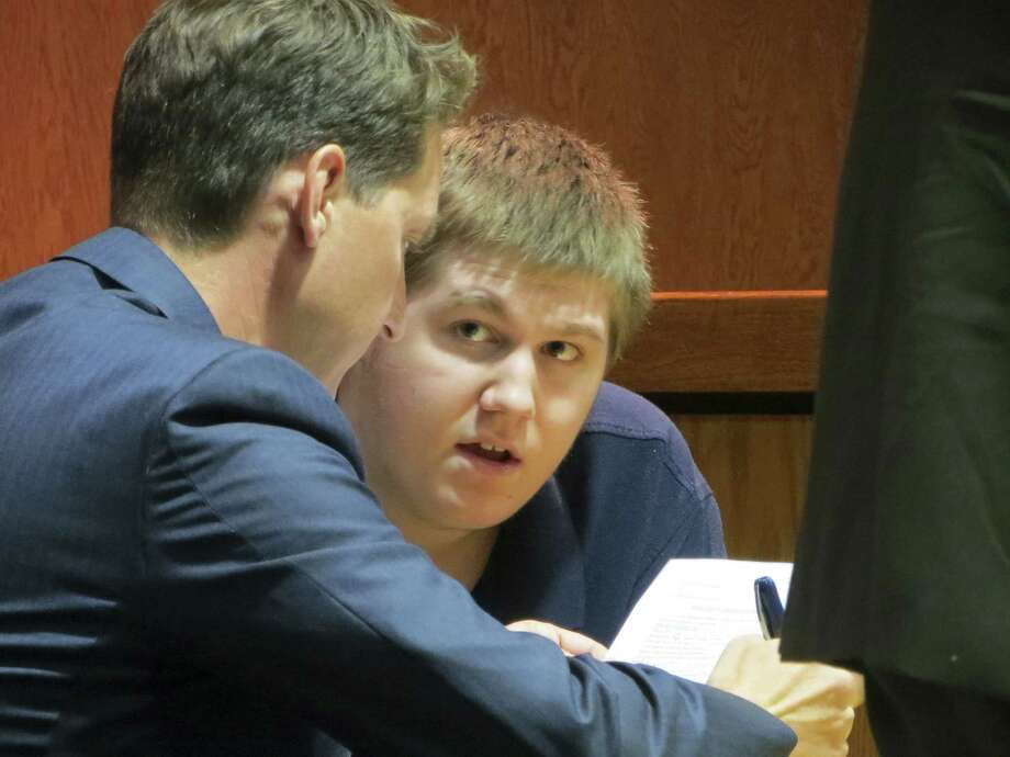 Justin Carter (right) faces a charge of making a terroristic threat over what the defense calls sarcastic remarks posted on Facebook about shooting up a kindergarten. Photo: Zeke MacCormack / San Antonio Express-News
