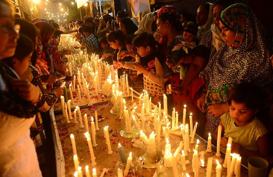 Pakistani Christian and activists of the Muttahida Qaumi Movement light candles for the victims of a suicide bombing that targeted a church in Karachi on September 23, 2013. Angry Christians protested across Pakistan to demand better protection after a devastating double suicide bombing at a church killed more than 80 people. TOPSHOTS/AFP PHOTO/RIZWAN TABASSUMRIZWAN TABASSUM/AFP/Getty Images Photo: Rizwan Tabassum, AFP/Getty Images