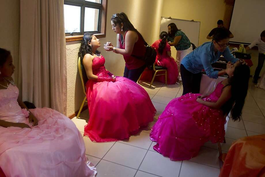 "Nicaraguan girls suffering from cancer prepare for a ""quinceanera"" party in Managua, Nicaragua, Saturday Sept. 21, 2013.   For each of the past five years, Nicaragua's Association of Mothers and Fathers of Children with Cancer and Leukemia has put on a ""quinceanera""  party for girls from poor, rural families, teens who have the added burden of dealing with cancer. This year's party feted 37 girls between ages 14 and 16 on Saturday night at a hotel in Nicaragua's capital.(AP Photo/Esteban Felix) Photo: Esteban Felix, Associated Press"