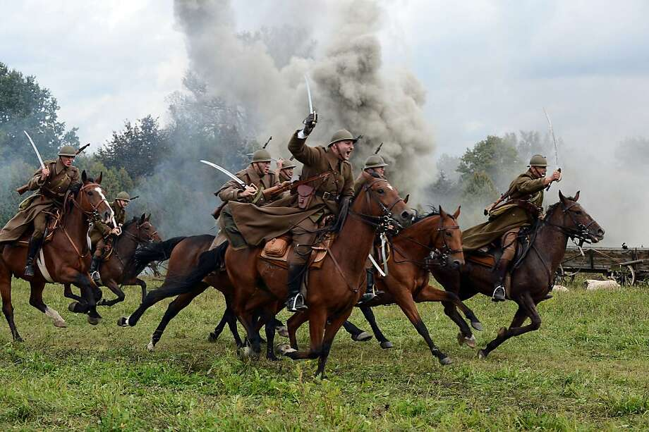 Onward, men! Our cavalry will most certainly thwart the German blitzkrieg!History buffs portray Polish horsemen attacking Wehrmacht motorized infantry near Lomianki during a World War II battle re-enactment. The cavalry charge, one of history's last mounted-horse attacks, occurred during the German invasion of Poland in 1939. Photo: Janek Skarzynski, AFP/Getty Images
