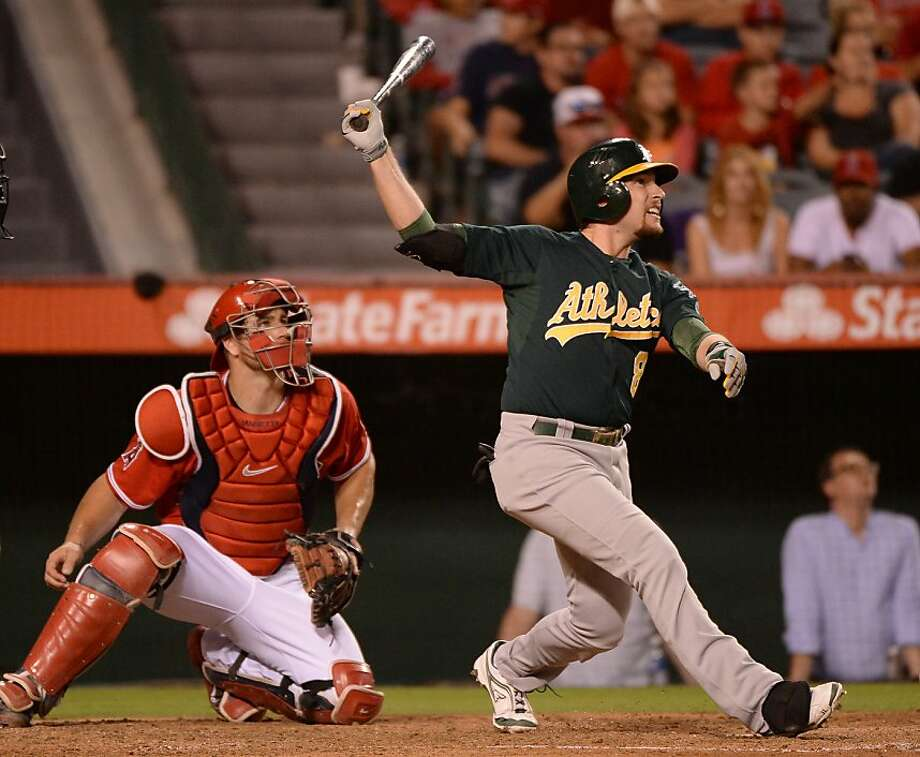Jed Lowrie follows the flight of his three-run homer in the third inning, a blast that gave the A's a 5-1 lead. Photo: Harry How, Getty Images