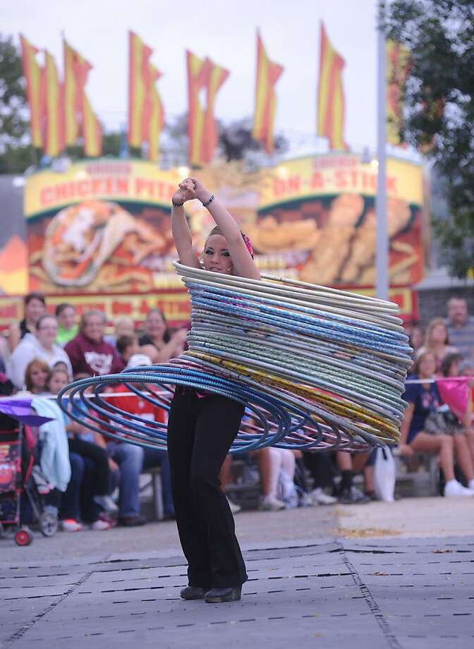 No, I will NOT share my hula hoops:Miss Mercedes Pages, a woman of many rings, performs at the Bloomsburg (Pa.) Fair. Photo: Mike Staugaitis, Associated Press