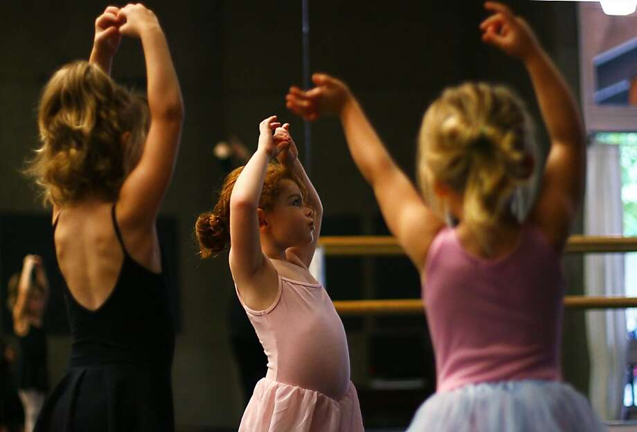 Josie Campbell, 5, practices third position in the sparkling stars dance class at the Ballet Fantastique Monday, Sept. 23, 2013. The class is taught by Lydia Rakov every Monday and is for ages four and up. Campbell has been dancing for one and a half years. (AP Photo /The Register-Guard, Tess Freeman) Photo: Tess Freeman, Associated Press