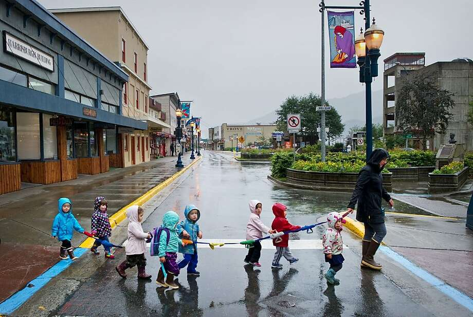 Christine Amor leads toddlers from the Discovery Preschool on a walk through a nearly deserted South Franklin Street in Juneau, Alaska, on Thursday, Sept. 19, 2013. The one cruise ship scheduled for the day was canceled. Juneau was forecast to receive 930,000 visitors by cruise ship during the May to September season. Wednesday, Sept. 25, is the last day of this years cruise ship season. (AP Photo/Juneau Empire, Michael Penn) Photo: Michael Penn, Associated Press