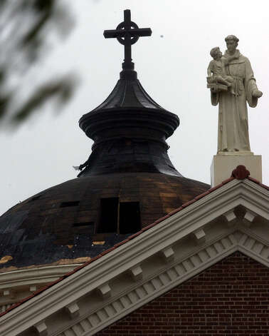 The recently renovated Saint Anthony Roman Catholic Cathedral shows damage to the dome after Hurricane Rita's winds took the new copper dome right off it's support structure.  (AP PHOTO/THE BEAUMONT ENTERPRISE, DAVE RYAN) Photo: DAVE RYAN, MBR / THE BEAUMONT ENTERPRISE