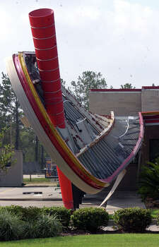 The top of the Sonic on Texas 105 in Beaumont, Texas, hangs at an angle Monday morning, Sept 26, 2005, after Hurricane Rita blew through on Saturday.