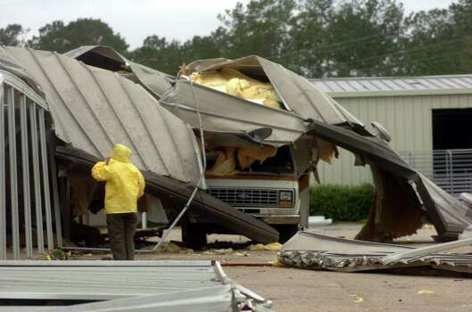 A camper was covered up by part of the roof of Newton High School when it blew off about 3:00 a.m. Saturday morning, Sept.24. The school had become a make-shift shelter for evacuees who stranded on the road when Rita blew through. When the storms rain started to come into the building, the approx. 70 evacuess were moved to area nursing homes.