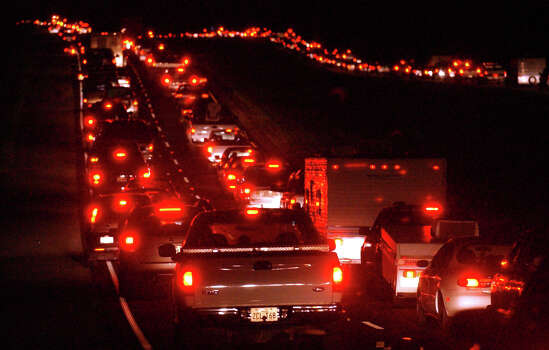 Traffic inches north in all four lanes along US Highway 96 north of Jasper in the middle of the night as Southeast Texans flee Hurricane Rita.