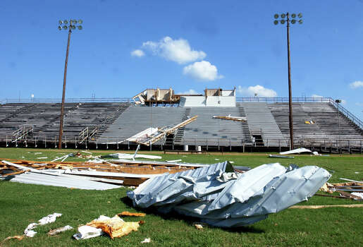 Debris from the press box at Kirby Memorial Stadium in Silsbee, Texas, where junior high school football games are played, litters the fifty yard line on Thursday morning almost two weeks after Hurricane Rita blew through Southeast Texas. (AP Photo/Beaumont Enterprise,Scott Eslinger) Photo: SCOTT ESLINGER, MBR / THE BEAUMONT ENTERPRISE