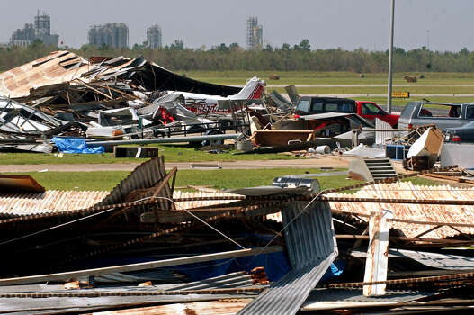 Planes, trucks and cars remain trapped under a demolished hangar at the Beaumont Municipal Airport in Beaumont on Monday, September 26. Hurricane Rita tore through the area on Saturday, September 24, 2005. (AP Photo/The Beaumont Enterprise, Mark M. Hancock) Photo: Mark M. Hancock, STAFF PHOTOGRAPHER / BEAUMONT ENTERPRISE