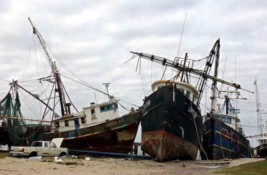 Shrimping ships on Fisherman's Warf in Sabine Pass remain smashed into one another on Saturday, October 8, 2005. (AP Photo/The Beaumont Enterprise, Mark M. Hancock) Photo: Mark M. Hancock, Staff Photographer / © 2005 The Beaumont Enterprise
