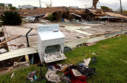 A home and its contents remains destroyed in Sabine Pass on Saturday, October 8, 2005. Hurricane Rita came ashore near the pass on September 24, 2005. (AP Photo/The Beaumont Enterprise, Mark M. Hancock) Photo: Mark M. Hancock, Staff Photographer / © 2005 The Beaumont Enterprise