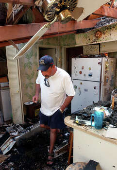 Frank Fuller walks through the kitchen of his mother and step-father's home in the West end of Beaumont, Texas Friday morning, Sept. 30, 2005. Hurricane Rita sent two trees crashing through the roof of the home last week; one across the kitchen and living room and one on top the room Fuller was staying in. (AP Photo/Beaumont Enterprise, Scott Eslinger) ** MAGS OUT, TV OUT, AP MEMBERS ONLY ** Photo: SCOTT ESLINGER, AP / THE BEAUMONT ENTERPRISE