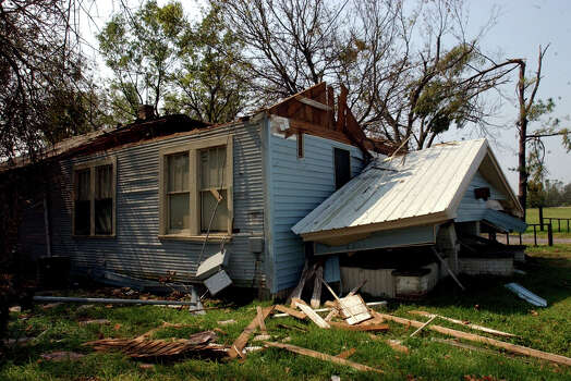 A house on Florida Street in the south end of Beaumont, Texas, sits in ruins Friday, Sept. 30, 2005, about a week after it was destroyed by Hurricane Rita. (AP Photo/Beaumont Enterprise,Scott Eslinger) ** MAGS OUT, TV OUT, AP MEMBERS ONLY ** Photo: SCOTT ESLINGER, AP / THE BEAUMONT ENTERPRISE