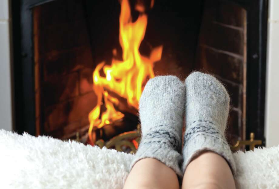 Fall is the time to whip out those thick, cozy socks. Bonus points if you toast your toes by the fire. (File photo) Photo: Photographer: Anton Balazh, Anton Balazh - Fotolia / © Anton Balazh, 2010