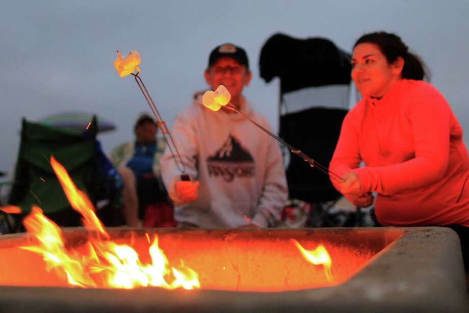 Fall is made for bonfires and s'mores, whether you're camping or not.(David McNew/Getty Images) Photo: David McNew, Getty / 2013 Getty Images
