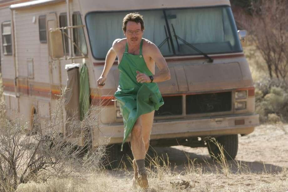 "In this photo released by AMC,Walter White (Bryan Cranston) runs for his life in the AMC drama series ""Breaking Bad"".(AP Photo/Doug Hyun,AMC) Photo: DOUG HYUN, AP"
