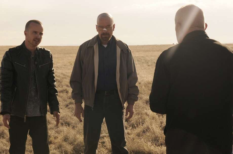 Jesse Pinkman (Aaron Paul) and Walter White (Bryan Cranston) and Mike (Jonathan Banks) - Breaking Bad - Season 5, Episode 1 - Photo Credit: Ursula Coyote Photo: Ursula Coyote