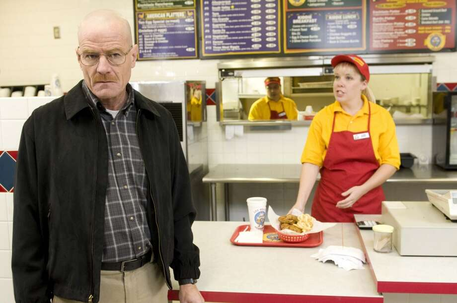 "This image released by AMC shows Bryan Cranston as Walter White at the fictional restaurant ""Los Pollos Hermanos"" in a scene from season 2 of the AMC series ""Breaking Bad.""  A Twisters burrito restaurant in Albuquerque that serves as the location for the restaurant has become an international tourist attraction as people come from all over the world to see the spot where a fictional drug trafficker runs his organization. (AP Photo/AMC) Photo: Uncredited, Associated Press"