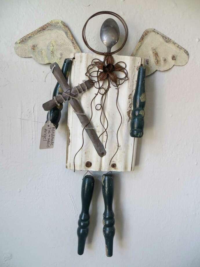 14398 Old Bandera Road: Handmade wood and tin angel, $20, at Not Too Shabby. Photo: Jennifer Rodriguez