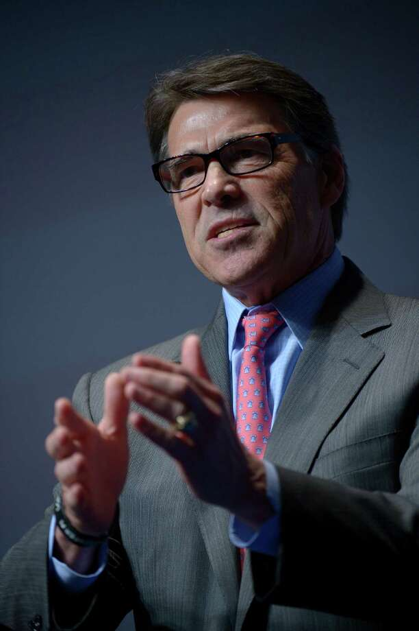 Texas Gov. Rick Perry addresses attendees during the Americans for Prosperity Foundation's Defending the American Dream Summit in Orlando, Fla., Friday, Aug. 30, 2013.(AP Photo/Phelan M. Ebenhack) Photo: Phelan M. Ebenhack, Associated Press / FR121174 AP