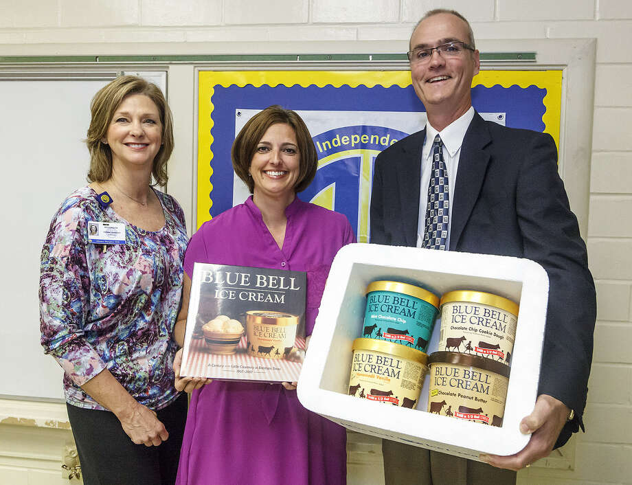 Woodridge Elementary School Principal Debbie Garinger (left) and Blue Bell Creameries branch manager Ron Dickson honored instructional technology specialist Charlotte Dolat (center) Sept. 18 for being an Education Service Center Region 20 Teacher of the Year. Blue Bell on Wednesday honored Hobby Middle School's Christian Deberry, a Texas Secondary Teacher of the Year finalist. Photo: Marvin Pfeiffer / North Central News
