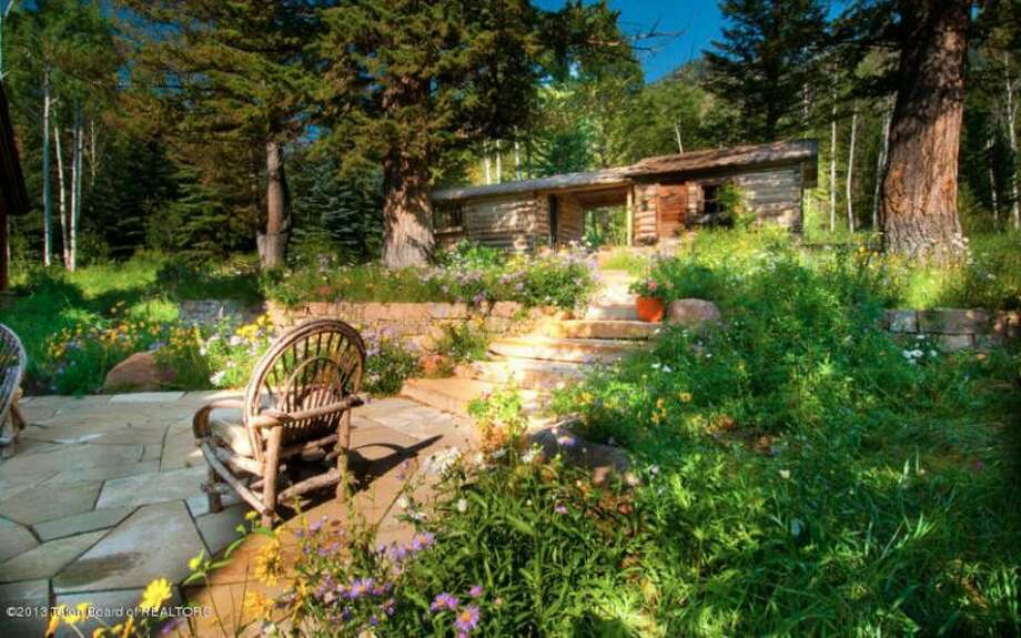 Patio area in foreground of cabin. All photos via Prugh Real Estate, Jackson Hole, WY Photo: Http://www.prughrealestate.com/properties/6895-n-bowman-rd-teton-village-wy-83025