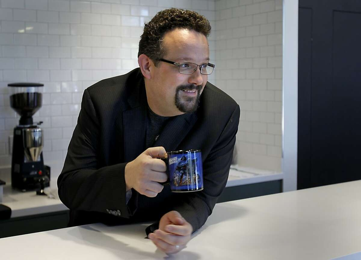 Phil Libin, chief executive of Evernote, enjoys a coffee after making lattes for his employees.