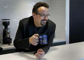 CEO Phil Libin finally enjoys his own coffee after making lattes for his employees at Evernote Thursday September 19, 2013 in Redwood City, Calif. Phil Liben is the CEO of Evernote, the online-based application for organization, that is taking on Microsoft Word and Google Docs.
