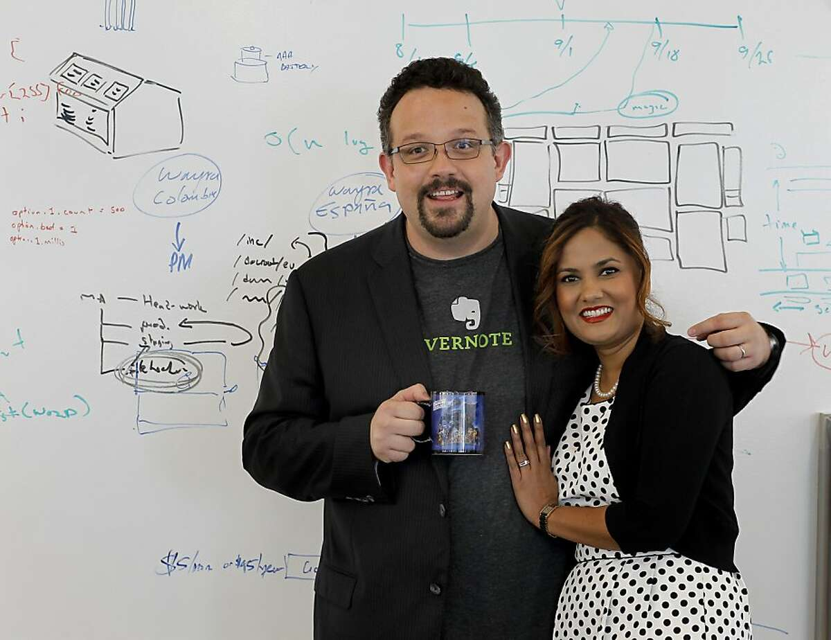 Phil Libin, chief executive of Evernote, with his wife, Sharmila Birbal, in front of one of the many idea walls at company headquarters in Redwood City where new apps and features roll out regularly.