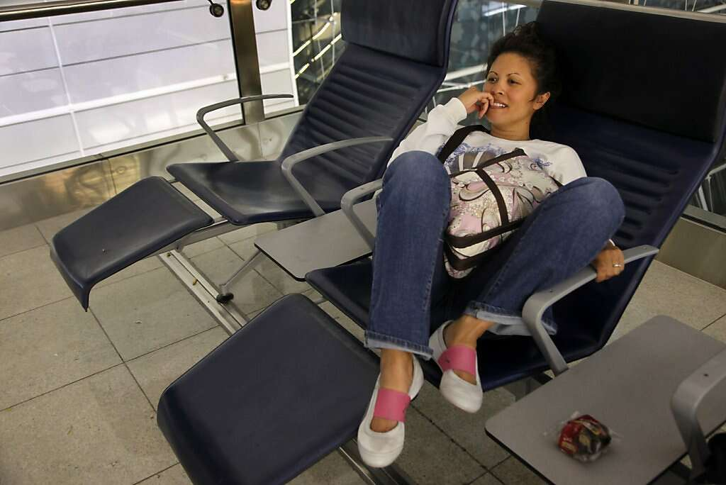 Jennifer Benito-Kowalski waits for her flight to India during a layover at Dubai International Airport in the United Arab Emirates on Tuesday, May, 21, 2013. Photo: Nicole Fruge, The Chronicle