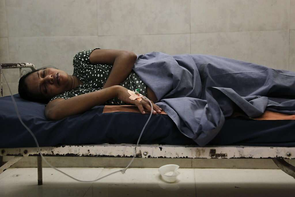 Surrogate Manisha Parmar tries to rest after receiving an intravenous line at the Akanksha Infertility Clinic in Anand, India, Thursday, May 23, 2013. Dr. Nayna Patel said she was in spontaneous labor, but Parmar delivered by cesarean section later that day. Photo: Nicole Fruge, The Chronicle