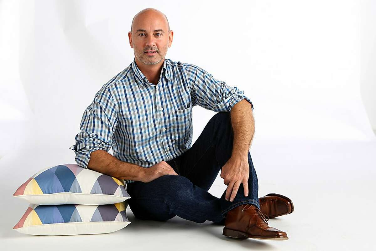 Owner Bradley Burch of Urban Mercantile in San Francisco, California, shows pillows by Iosis on Monday, September 9, 2013.