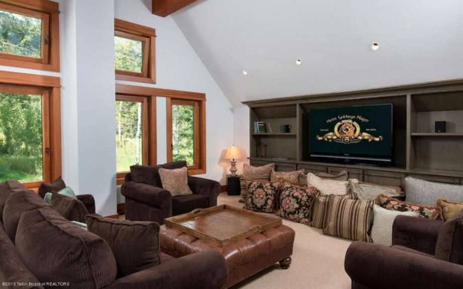 Friendly-feeling theater/media room. All photos via Prugh Real Estate, Jackson Hole, WY Photo: Http://www.prughrealestate.com/properties/6895-n-bowman-rd-teton-village-wy-83025
