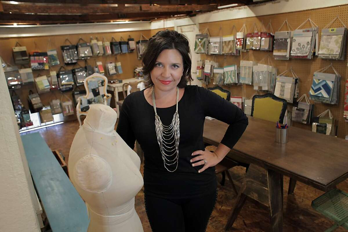 Johnelle Mancha, owner of Mignonne Home Design in Berkeley, Calif, is seen here in the fabric workshop at her store on Wednesday, September 11, 2013. Mancha has crafted a shop where she can reinvent furniture pieces from vintage finds.