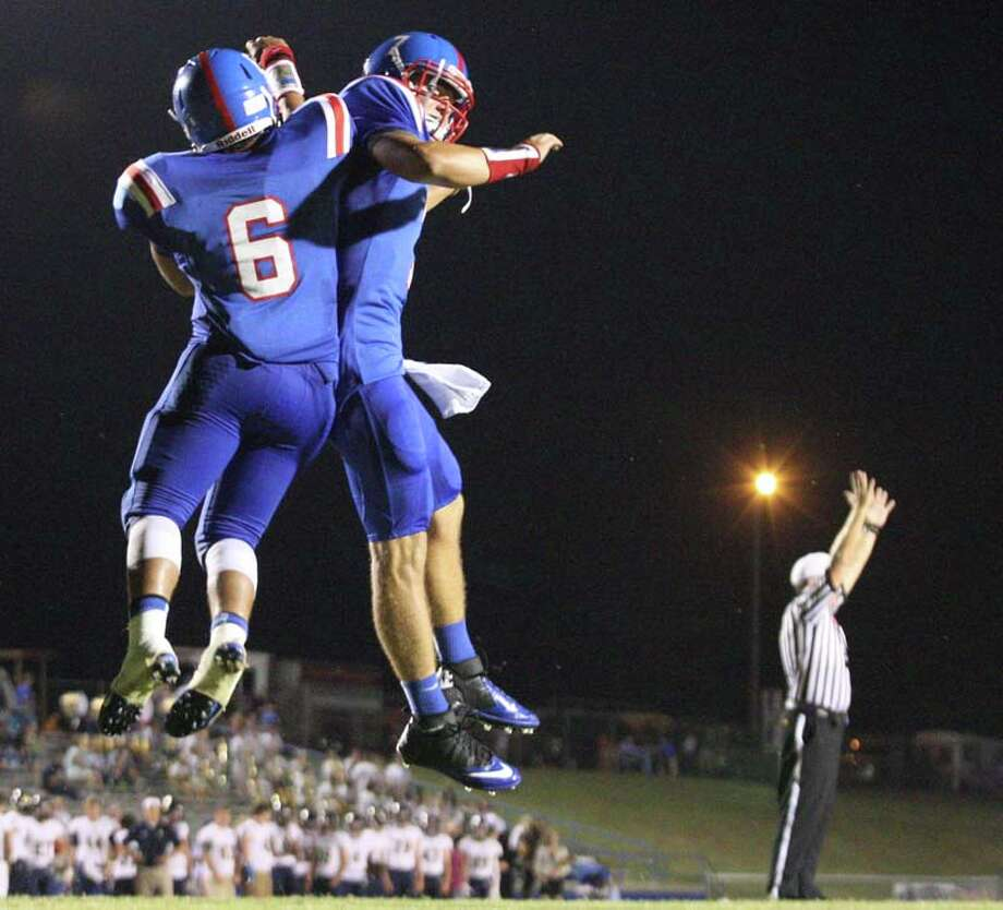 Friday night lights Photo: C.B. Schmelter, Associated Press / Chattanooga Times Free Press