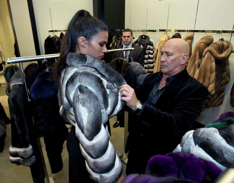 Fur wraps at society events Photo: James Nielsen, Houston Chronicle / © Houston Chronicle 2012