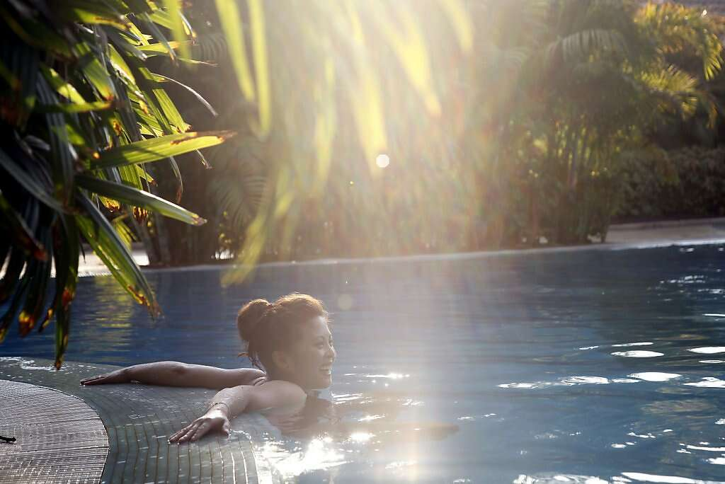Five days after his birth, Jennifer Benito-Kowalski leaves Kyle with husband Steve for the first time and takes a quick dip in the pool at the Madhubhan Resort and Spa in Anand, India, Tuesday, May 28, 2013. Photo: Nicole Fruge, The Chronicle