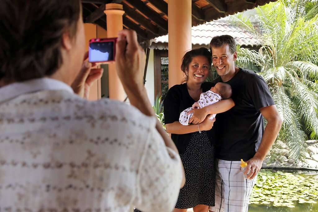 Sue Kowalski takes a family portrait of son Steve, grandson Kyle, and daughter-in-law Jennifer at the Madhubhan Resort and Spa in Anand, India, Thursday, May 30, 2013. Photo: Nicole Fruge, The Chronicle