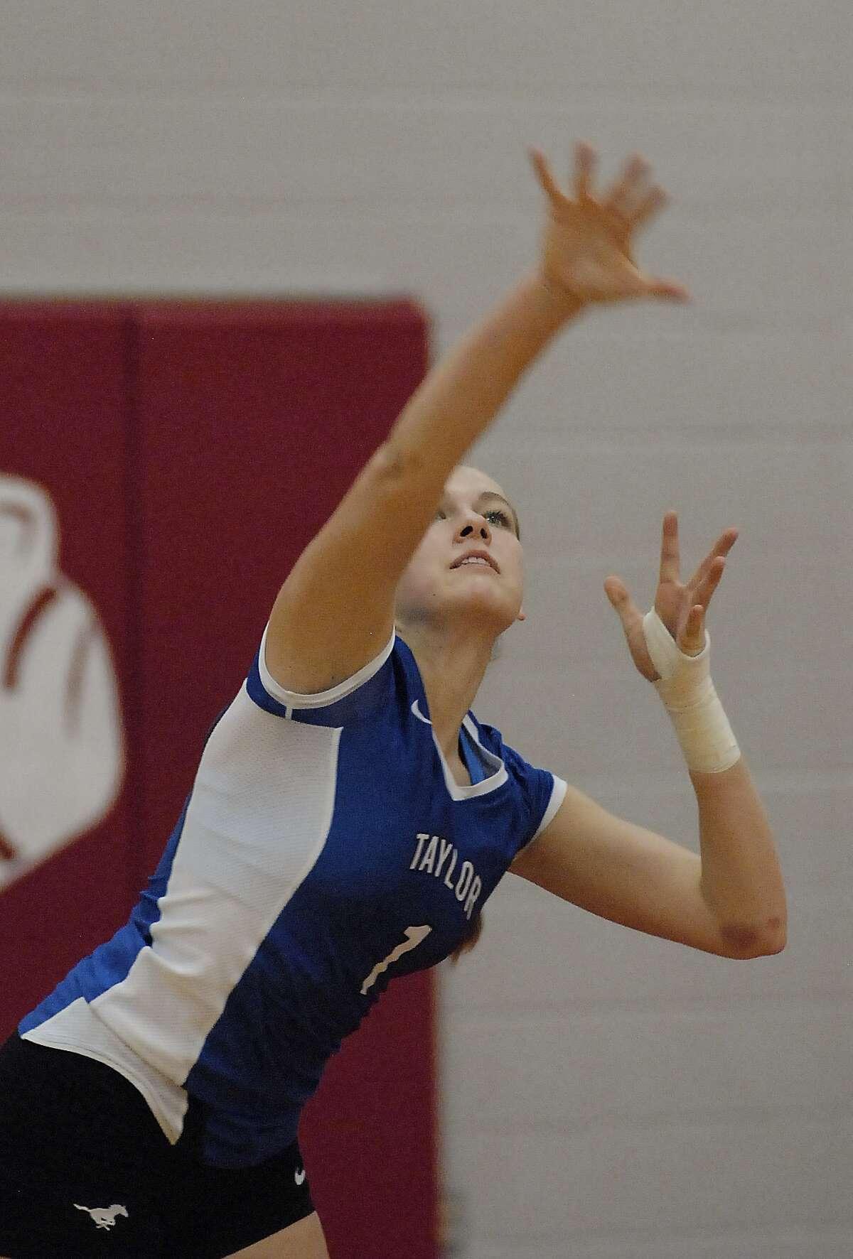 "Katy Taylor 5'6"" senior Cailin Scherpereel (#1) serves during their game at Katy High School Friday 9/20/13."