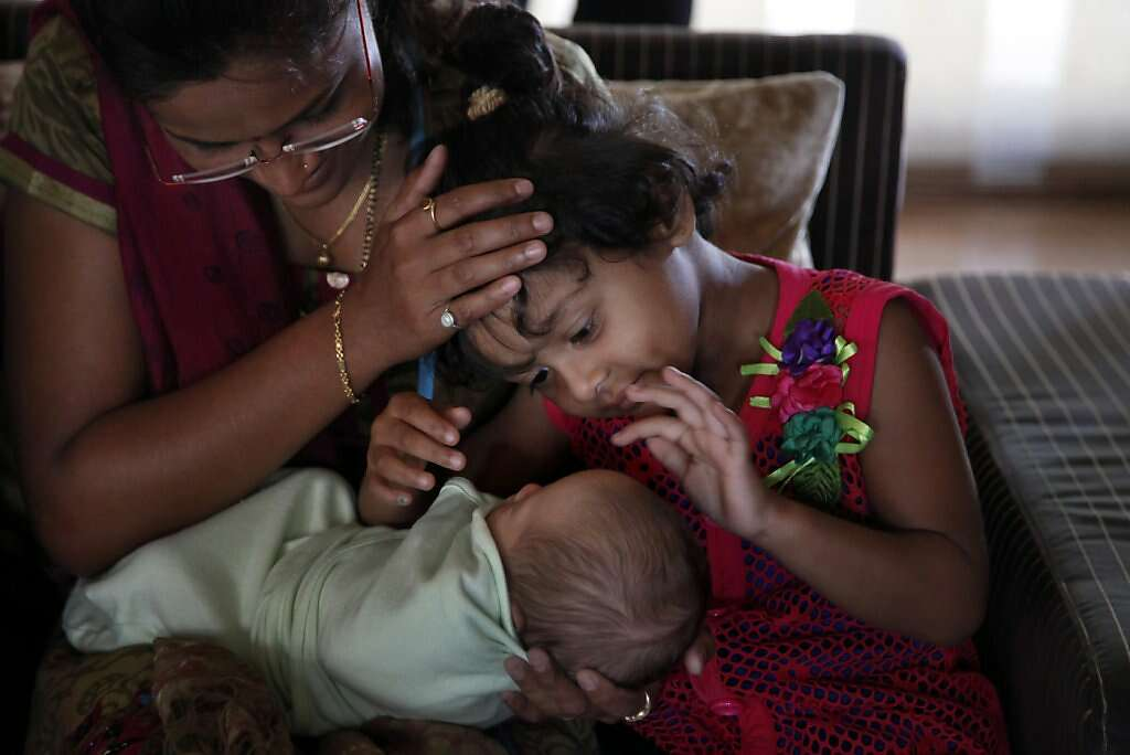 Hotel guests meet baby Kyle Benito-Kowalski at the Madhubhan Resort and Spa in Anand, India, Tuesday, May 28, 2013. Photo: Nicole Fruge, The Chronicle