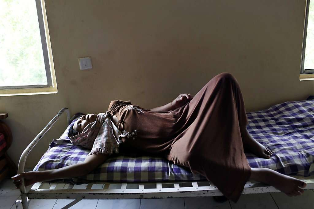 Manisha Parmar struggles with waves of pain three days after a cesarean section at the Akanksha Infertility Clinic, Sunday, May 26, 2013, in Anand, India. Photo: Nicole Fruge, The Chronicle