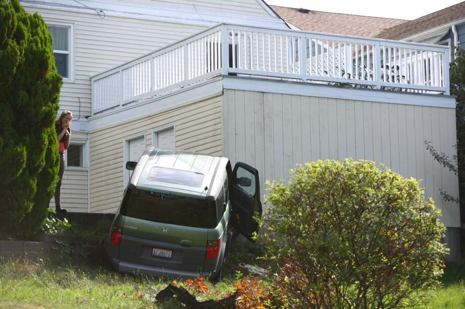 An 83-year-old woman left the road and hit an embankment outside a house Tuesday morning in the Wedgwood neighborhood. Medics took the woman to the hospital in satisfactory condition. Joshua Trujillo/seattlepi.com