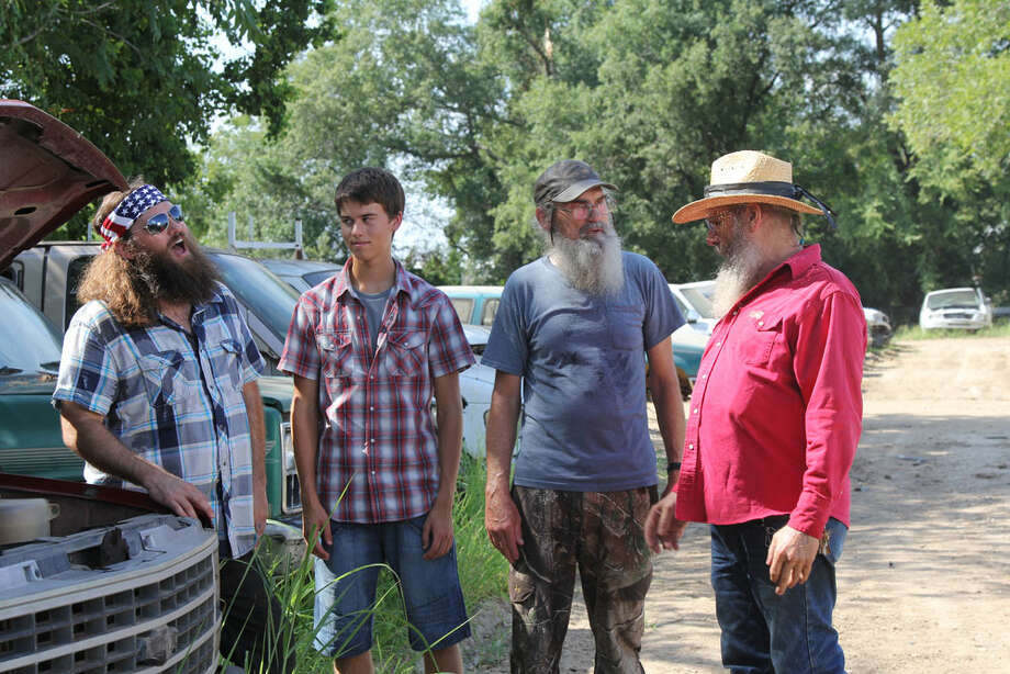 Willie and Si take John Luke to buy his first car. Photo: Gurney Productions, A&E