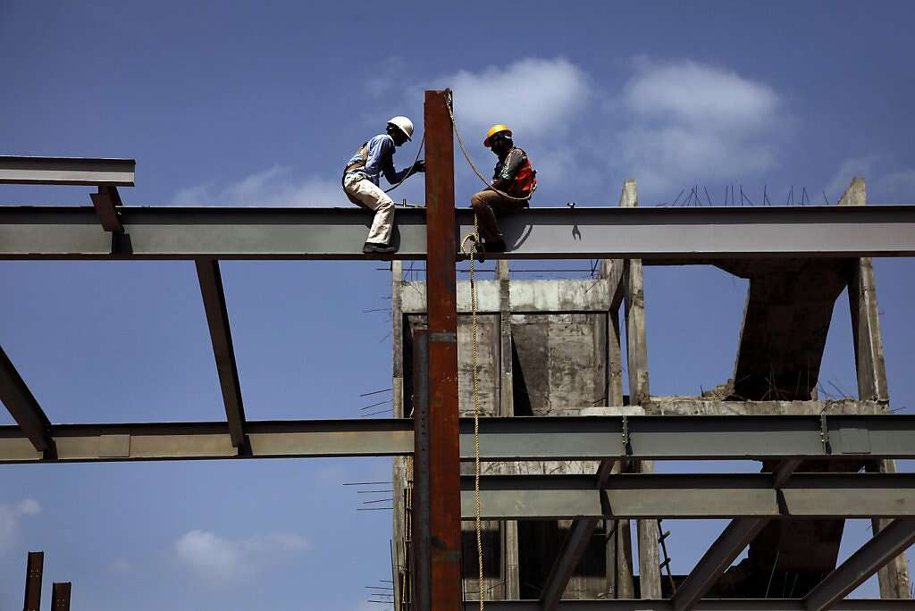 Workers build a 100,000-square-foot Akanksha Infertility Clinic facility in Anand, India, Wednesday, May 29, 2013. This huge headquarters will be a one-stop location, with lodging for clients and surrogates atop spacious delivery rooms and offices. Photo: Nicole Fruge, The Chronicle