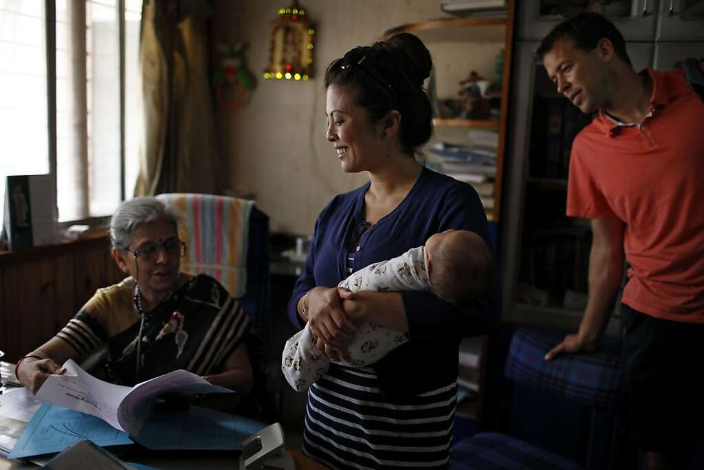 Pediatrician Dr. Anita Kothiala meets with Jennifer Benito-Kowalski and Steve Kowalski during a vaccination appointment for baby Kyle at the Apara Nursing Home, Monday, May 27, 2013, in Anand, India. Photo: Nicole Fruge, The Chronicle