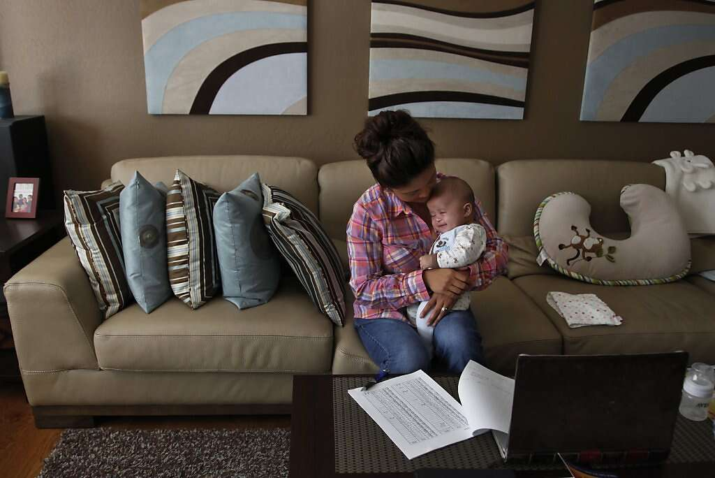 Jennifer Benito-Kowalski holds son Kyle in their home in San Carlos, Calif., Wednesday, August 7, 2013. Photo: Nicole Fruge, The Chronicle