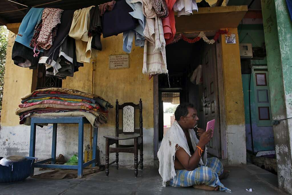 A relative of Raman Parmar shaves in Khambhat, India, Monday, June 3, 2013. Photo: Nicole Fruge, The Chronicle