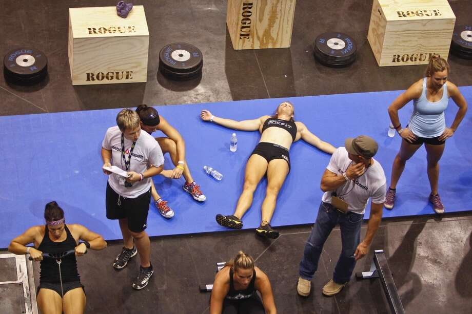 A competitor takes a break from the CrossFit challenge after competing in a timed event at the UFC Fan Expo at the George R. Brown Convention Center, Friday, Oct. 7, 2011, in Houston. 