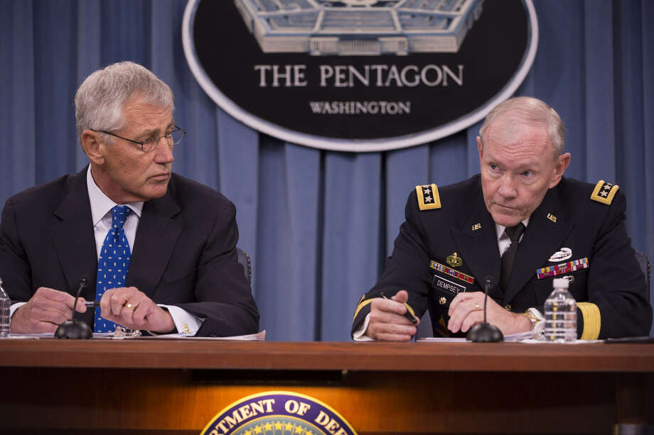 Defense Secretary Chuck Hagel and Army Gen. Martin E. Dempsey, chairman of the Joint Chiefs of Staff, brief reporters during a news conference Sept. 18 at the Pentagon. Photo: DOD
